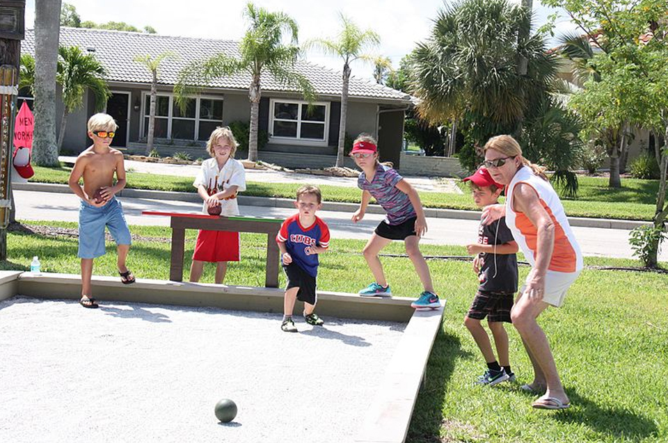Build a bocce ball court in your back yard. Photo of kids playing it.