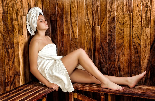woman enjoying herself inside a sauna room